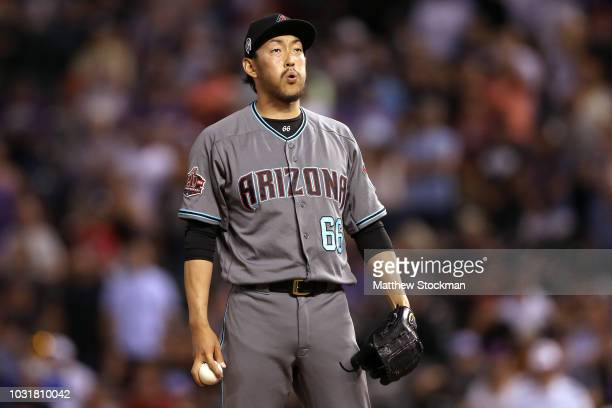 Pitcher Yoshihisa Hirano of the Arizona Diamondbacks throws in the ninth inning against the Colorado Rockies at Coors Field on September 11 2018 in...