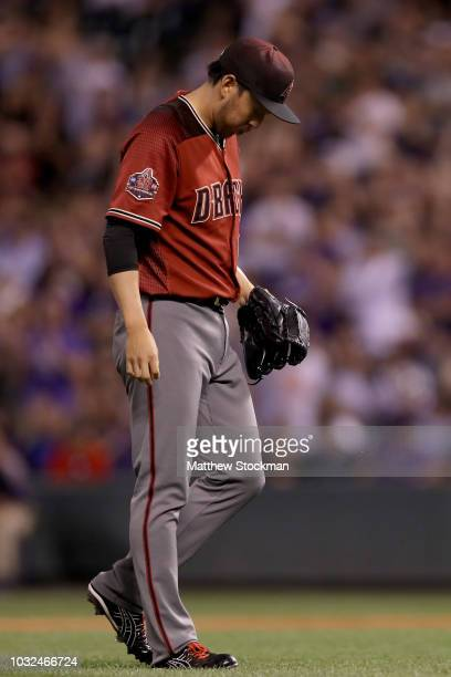 Pitcher Yoshihisa Hirano of the Arizona Diamondbacks walks to the mound in the ninth inning against the Colorado Rockies at Coors Field on September...