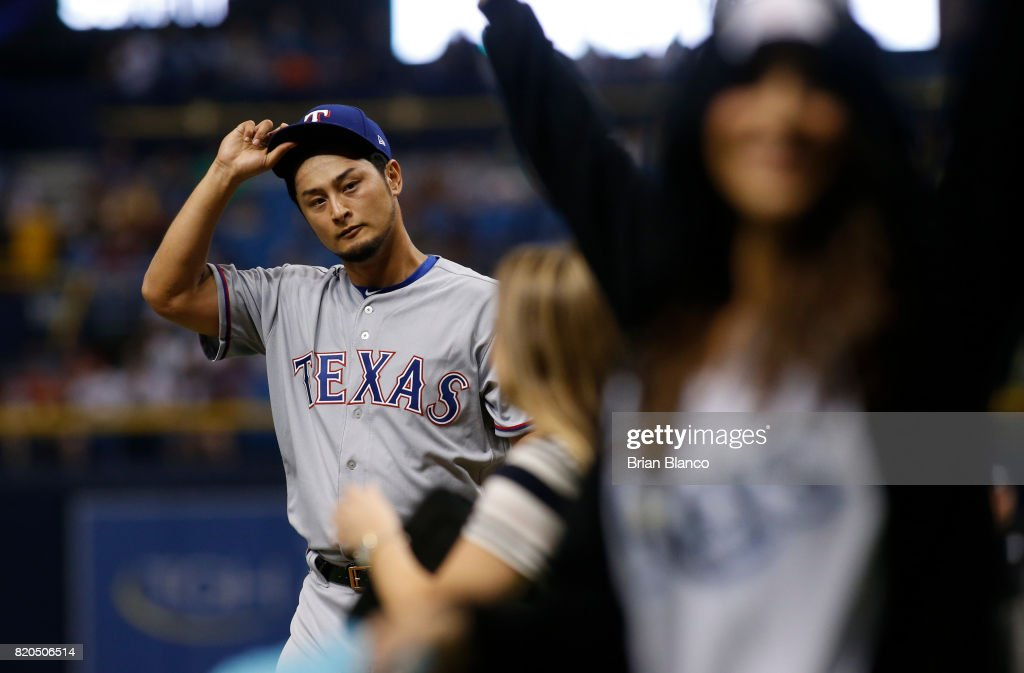 Pitcher Yu Darvish #11 of the Texas Rangers makes his way to the dugout at the end of the fourth inning of a game against the Tampa Bay Rays on July 21, 2017 at Tropicana Field in St. Petersburg, Florida.