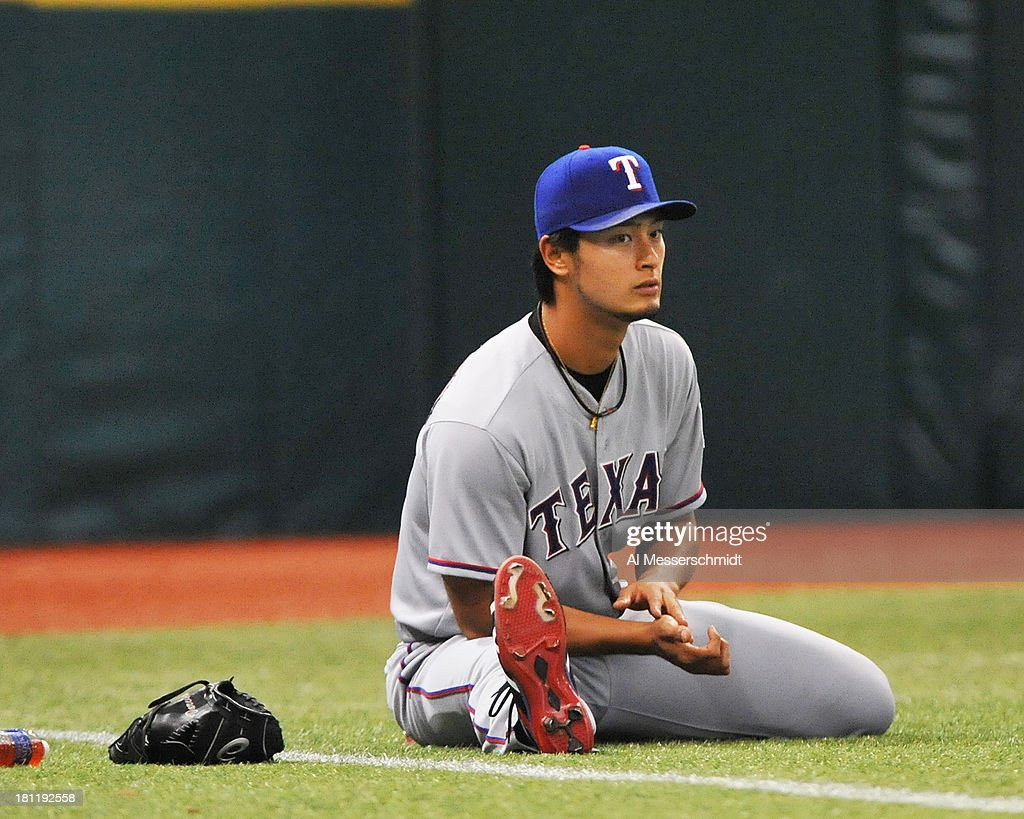 Pitcher Yu Darvish #11 of the Texas Rangers warms up before starting against the Tampa Bay Rays September 19, 2013 at Tropicana Field in St. Petersburg, Florida.