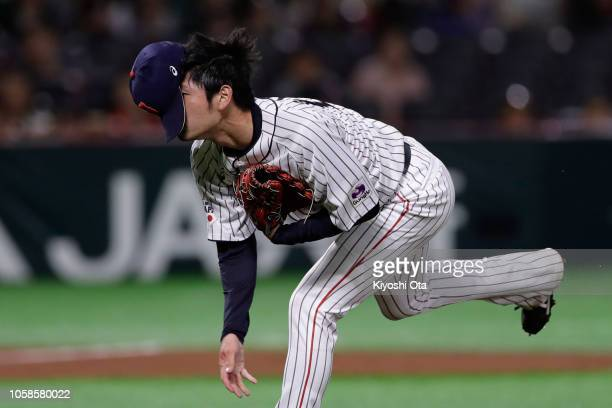 Pitcher Yu Satoh of Japan delivers a pitch in the top of 7th inning during the baseball friendly between Japan and Chinese Taipei at Fukuoka Yahuoku...