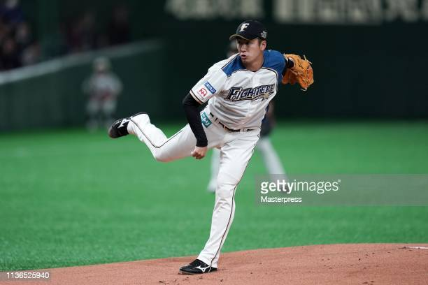 Pitcher Yuki Saito of the Hokkaido NipponHam Fighters throws during the preseason friendly game between Hokkaido NipponHam Fighters and Oakland...