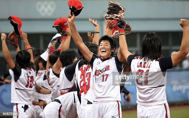 Pitcher Yukiko Ueno of the Japan's women's softball team facing celebrates Japan's gold medal victory on day 13 of the 2008 Beijing Olympics in...