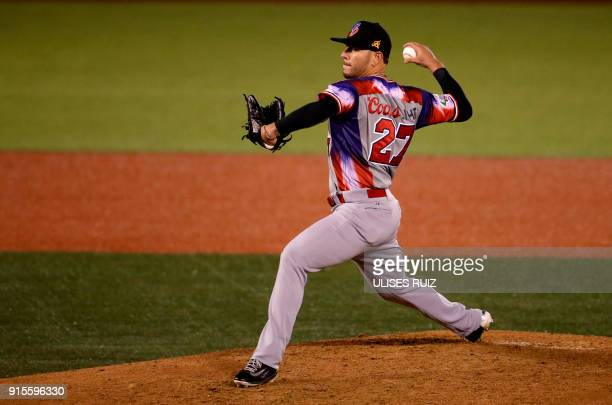 Pitcher Yunesky Maya of Aguilas Cibaenas of Republica Dominicana throws against Alazanes del Granma of Cuba during the Caribbean Baseball Series at...