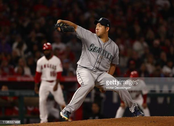 Pitcher Yusei Kikuchi of the Seattle Mariners pitches in the fifth inning with a runner Brian Goodwin of the Los Angeles Angels of Anaheim on third...
