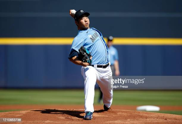 Pitcher Yusei Kikuchi of the Seattle Mariners throws against the San Diego Padres during the first inning of a Cactus League spring training baseball...