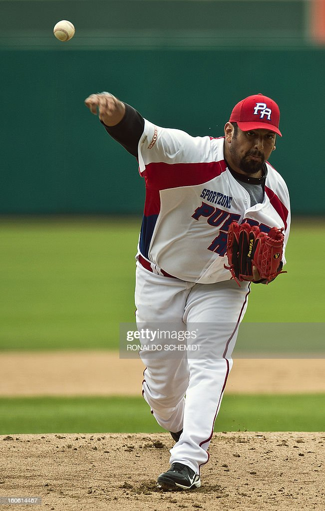 Pitcher Zack Segovia of Criollos de Cagua of Puerto Rico, pitches against Magallanes of Venezuela during the 2013 Caribbean baseball series, on February 3, 2013, in Hermosillo, Sonora State, in the northern of Mexico. AFP PHOTO/Ronaldo Schemidt