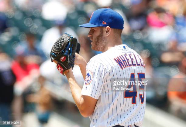 Pitcher Zack Wheeler of the New York Mets looks in for a sign in an interleague MLB baseball game against the Baltimore Orioles on June 6 2018 at...