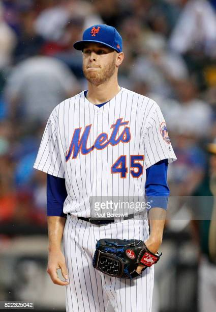Pitcher Zack Wheeler of the New York Mets reacts during an interleague MLB baseball game against the Oakland Athletics on July 22 2017 at CitiField...