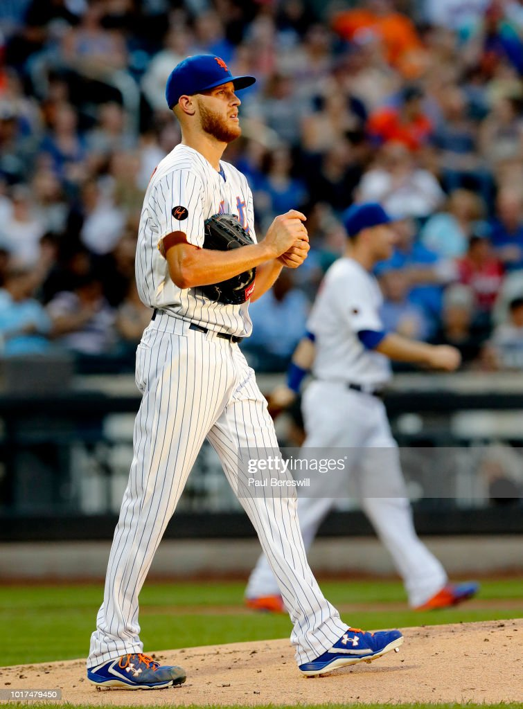 Pitcher Zack Wheeler #45 of the New York Mets reacts in an MLB baseball game against the Atlanta Braves on August 4, 2018 at Citi Field in the Queens borough of New York City. Mets won 3-0.