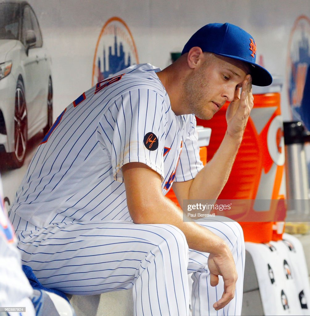 Pitcher Zack Wheeler #45 of the New York Mets reacts in the dugout during an MLB baseball game against the Miami Marlins on May 22, 2018 at Citi Field in the Queens borough of New York City. Marlins won 5-1.