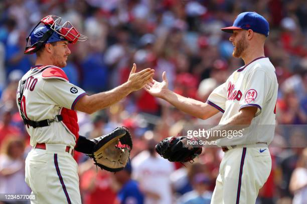 Pitcher Zack Wheeler of the Philadelphia Phillies is congratulated by catcher J.T. Realmuto after pitching a two-hit complete game shutout against...