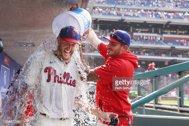 Pitcher Zack Wheeler of the Philadelphia Phillies is doused with water by Zach Eflin after pitching a two-hit complete game shutout against the New...