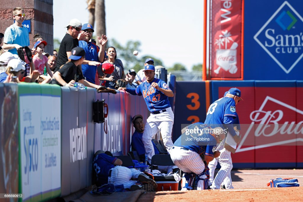 Pitchers and catchers in the New York Mets bullpen scatter as a foul ball lands near the left field wall during a Grapefruit League spring training game against the Miami Marlins at Tradition Field on March 22, 2017 in Port St. Lucie, Florida. The Marlins defeated the Mets 15-9.