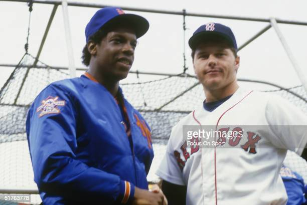 Pitchers Dwight Gooden and Roger Clemens of the Boston Red Sox talks to the media during the World Series at Fenway Park on October 1986 in Boston...