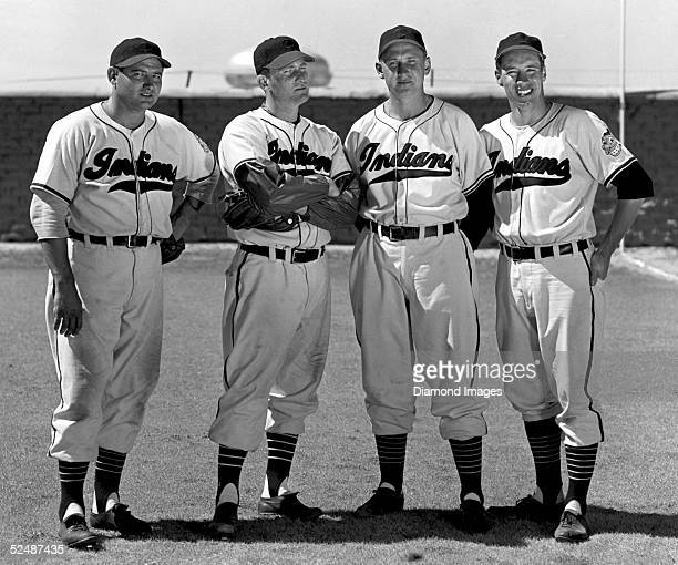 Pitchers Early Wynn Bob Lemon Steve Gromek and Bob Feller of the Cleveland Indians pose together during Spring Training in 1949 in Tucson Arizona
