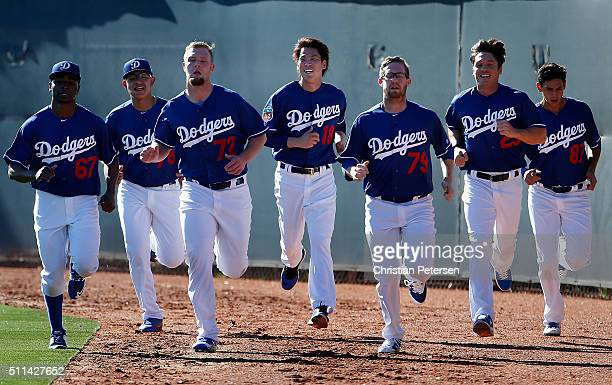 Pitchers Jharel Cotton Julio Urias 78 Chris Anderson Kenta Maeda Jacob Rhame Scott Kazmir and Jose De Leon of the Los Angeles Dodgers participates in...