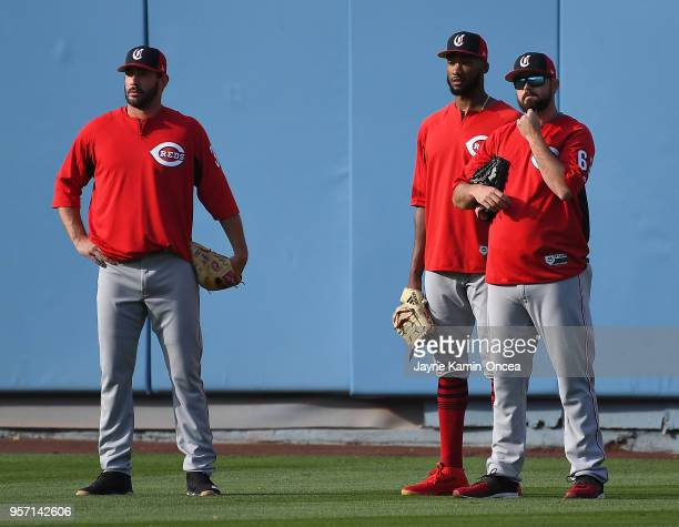 Pitchers Matt Harvey Amir Garrett and Jackson Stephens of the Cincinnati Reds stand in the outfield during batting practice before the game against...