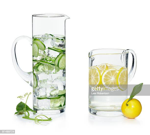 Pitchers of water with cucumber and lemon slices