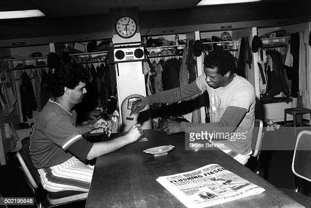 Pitchers Rick Aguilera and Dwight Gooden of the New York Mets play cards in the locker room before an MLB game circa 1985 at Shea Stadium in Flushing...