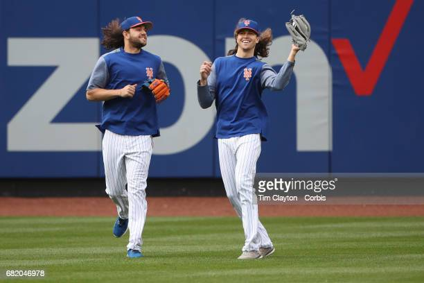 Pitchers Robert Gsellman of the New York Mets and Jacob deGrom of the New York Mets catching fly ball during batting practice before the San...