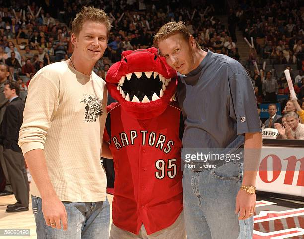 MLB pitchers Roy Halladay and AJ Burnett stand with the Raptors Mascot during a game between the Toronto Raptors and the Washington Wizards on...