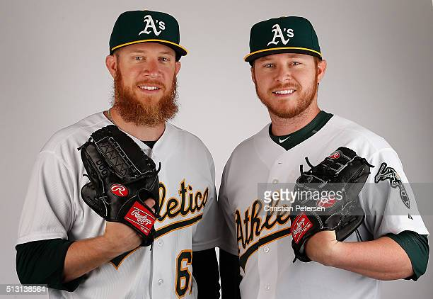 Pitchers Sean Doolittle and Ryan Doolittle of the Oakland Athletics pose for a portrait during the spring training photo day at HoHoKam Stadium on...