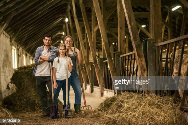Pitchfork cattle farmer family portrait