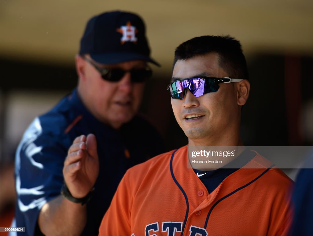Pitching coach Brent Strom #56 of the Houston Astros congratulates Norichika Aoki #3 on a sacrifice that scored Yuli Gurriel #10 during the seventh inning of the game on May 31, 2017 at Target Field in Minneapolis, Minnesota. The Astros defeated the Twins 17-6.