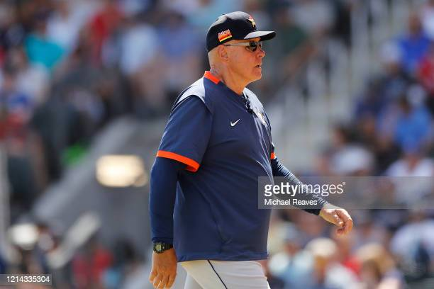 Pitching coach Brent Strom of the Houston Astros looks on against the Atlanta Braves during a Grapefruit League spring training game at CoolToday...