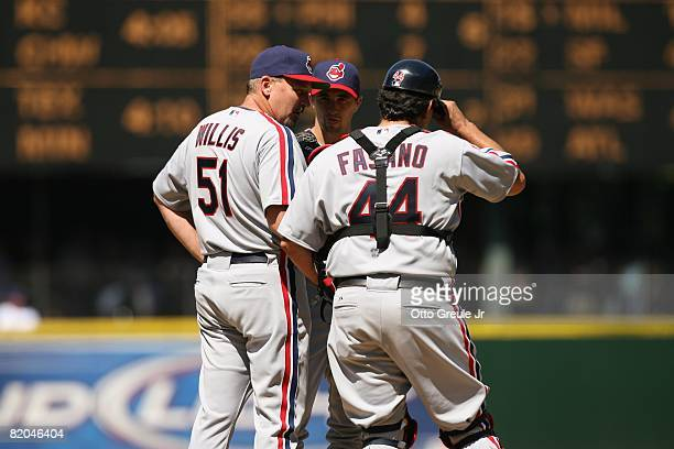 Pitching coach Carl Willis meets with Jeremy Sowers and catcher Sal Fasano of the Cleveland Indians during the game against the Seattle Mariners on...