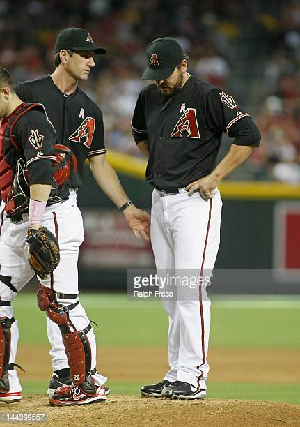 Pitching coach Charles Nagy of the Arizona Diamondbacks makes a mound visit to settle pitcher Joe Saunders during the fifth inning of a MLB game...