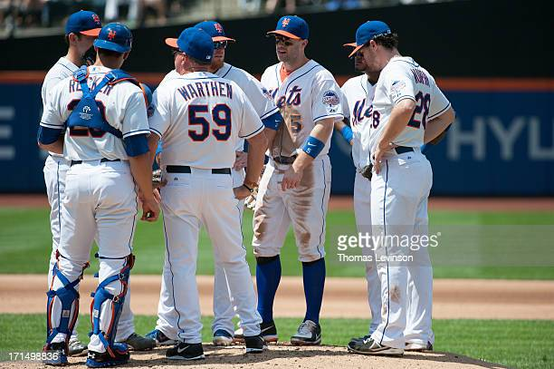 Pitching coach Dan Warthen Jonathon Niese and Anthony Recker of the New York Mets have a mound visit during the game against the Chicago Cubs on...