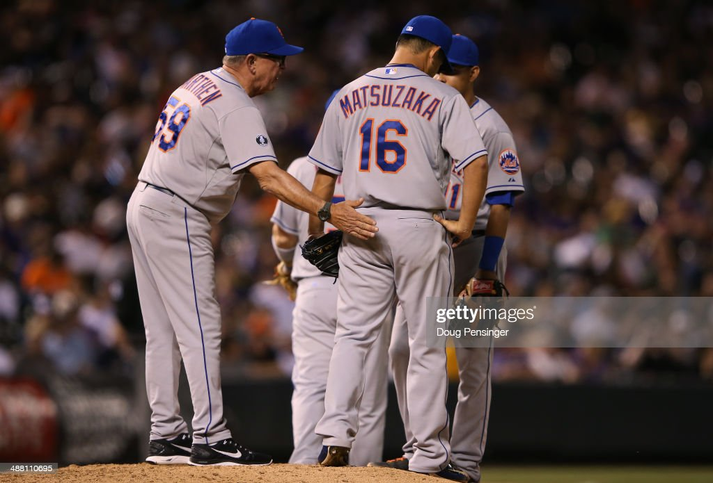 Pitching coach Dan Warthen #59 of the New York Mets visits the mound to check on relief pitcher Daisuke Matsuzaka #16 of the New York Mets as he works against the Colorado Rockies in the seventh inning at Coors Field on May 3, 2014 in Denver, Colorado. The Rockies defeated the Mets 11-10.
