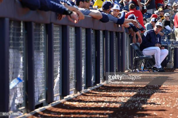 Pitching coach Darren Balsley of the San Diego Padres sits on the bench during the spring training game against the Los Angeles Angels at Peoria...