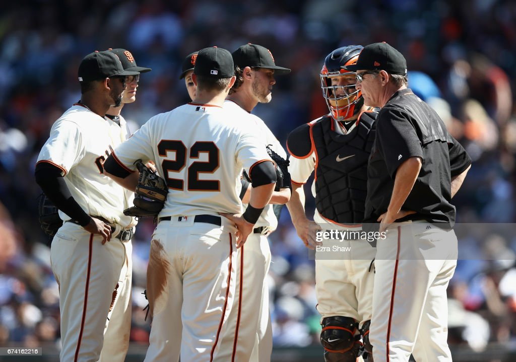 Pitching coach Dave Righetti #19 of the San Francisco Giants and the rest of the infield talk to Steven Okert #48 of the San Francisco Giants in the 10th inning against the Los Angeles Dodgers at AT&T Park on April 27, 2017 in San Francisco, California.