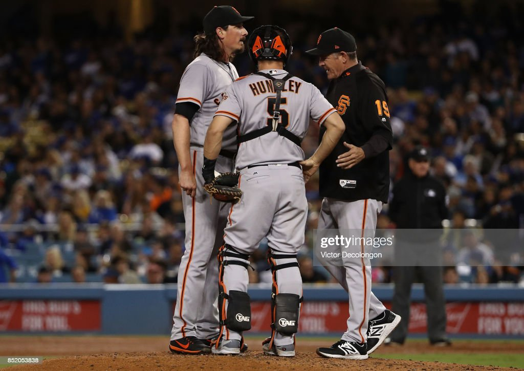Pitching coach Dave Righetti #19 of the San Francisco Giants visits the mound to talk with pitcher Jeff Samardzija #29 and catcher Nick Hundley #5 during the third inning of the MLB game against the Los Angeles Dodgers at Dodger Stadium on September 22, 2017 in Los Angeles, California.