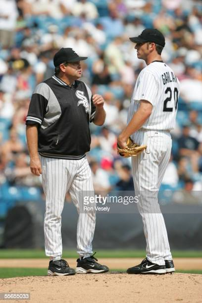 Pitching coach Don Cooper of the Chicago White Sox talks to Jon Garland during the fifth inning of the game against the Los Angeles Angels of Anaheim...