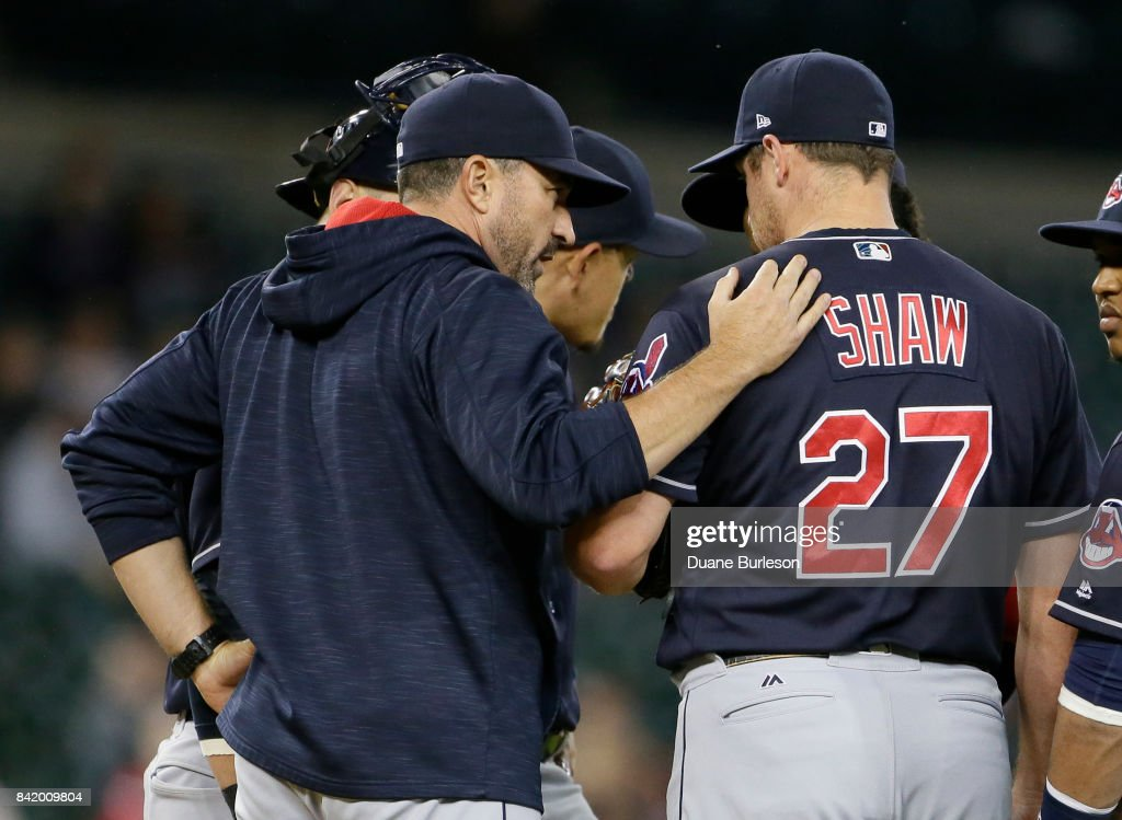 Pitching coach Jay Bruce #32 of the Cleveland Indians talks with pitcher Bryan Shaw #27 of the Cleveland Indians during the ninth inning at Comerica Park on September 2, 2017 in Detroit, Michigan. The Indians defeated the Tigers 5-2.