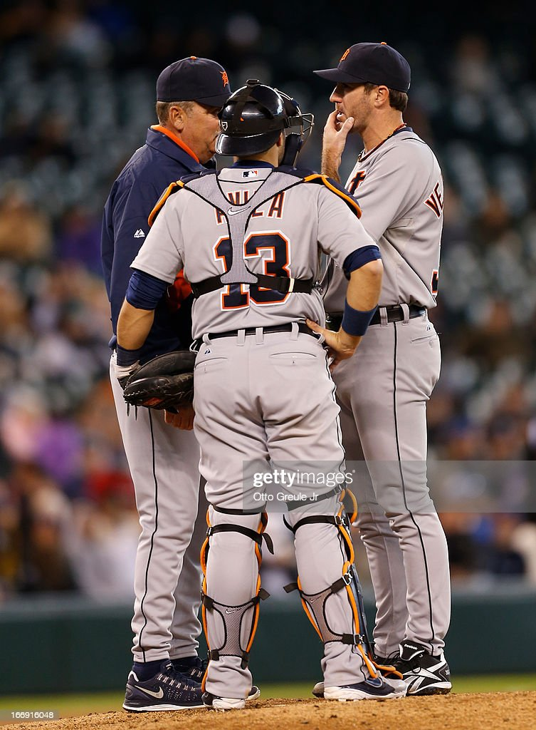 Pitching coach Jeff Jones #51 and catcher Alex Avila #13 of the Detroit Tigers confer with starting pitcher Justin Verlander #35 after he gave up a single to Robert Andino of the Seattle Mariners in the seventh inning at Safeco Field on April 18, 2013 in Seattle, Washington.