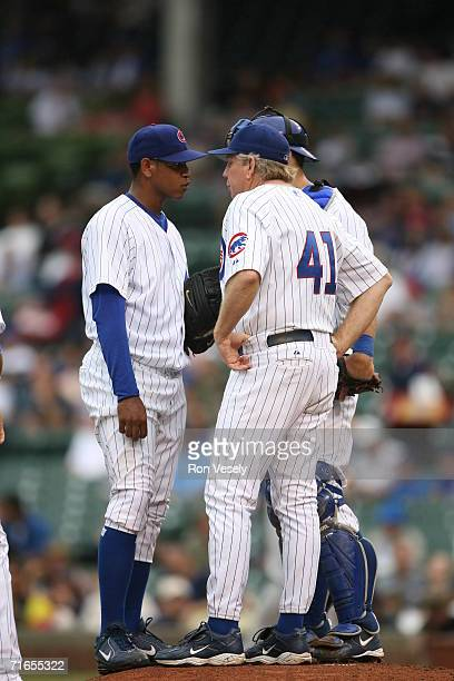 Pitching coach Larry Rothschild Michael Barrett and Carlos Marmol of the Chicago Cubs chat on the mound during the game against the Arizona...