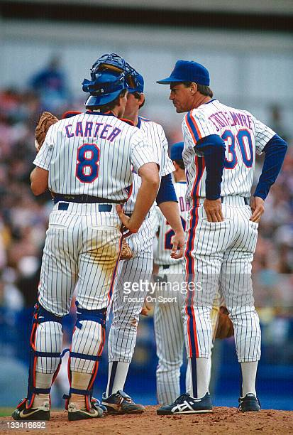 Pitching coach Mel Stottlemyre of the New York mets come out to talk with his pitcher and Gary Carter his catcher during an Major League Baseball...