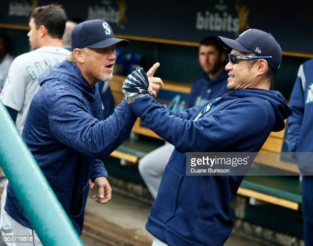 Pitching coach Mel Stottlemyre of the Seattle Mariners jokes with interim bench coach Ichiro Suzuki of the Seattle Mariners right before game one of...