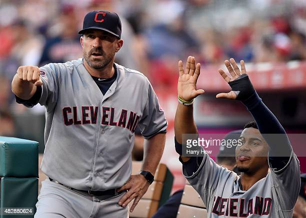 Pitching Coach Mickey Callaway of the Cleveland Indians and Francisco Lindor react to a two run from home from Yan Gomes to take a 30 lead over the...