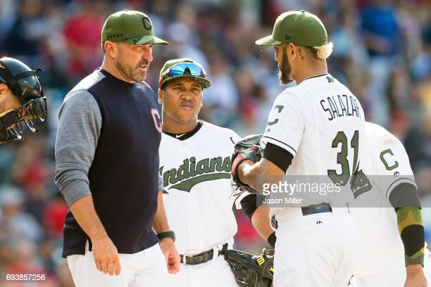 Pitching coach Mickey Callaway of the Cleveland Indians talks to starting pitcher Danny Salazar during the sixth inning against the Kansas City...