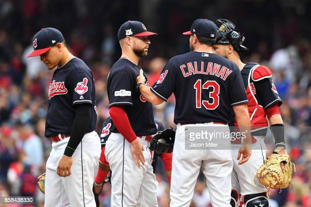 Pitching coach Mickey Callaway talks to Corey Kluber of the Cleveland Indians on the mound in the first inning against the New York Yankees during...