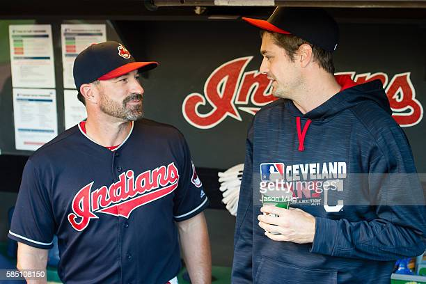 Pitching coach Mickey Callaway talks with new relief pitcher Andrew Miller of the Cleveland Indians prior to the game against the Minnesota Twins at...