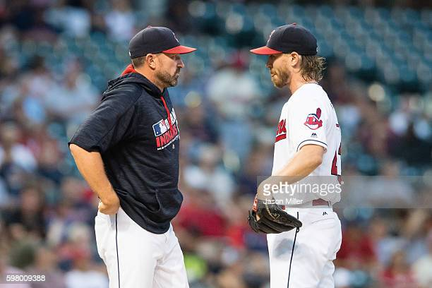 Pitching coach Mickey Callaway talks with starting pitcher Josh Tomlin of the Cleveland Indians during the second inning against the Minnesota Twins...