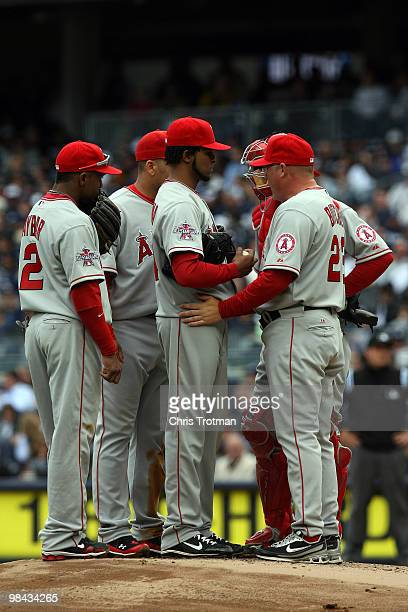 Pitching coach Mike Butcher talks with starting pitcher Ervin Santana of the Los Angeles Angels of Anaheim during a visit to the mound against the...