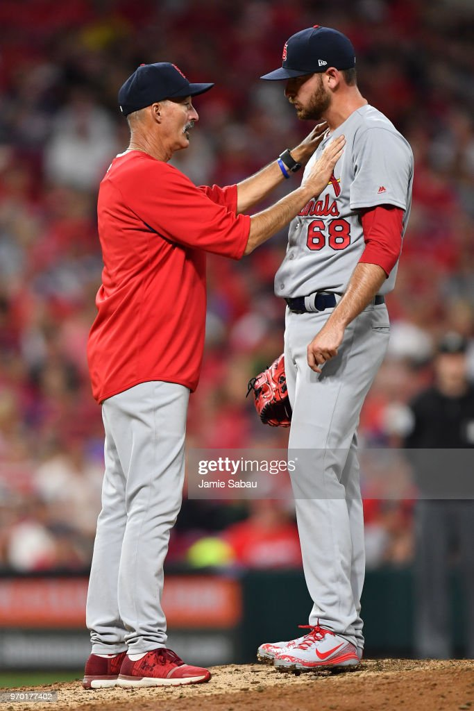 Pitching Coach Mike Maddux #31 of the St. Louis Cardinals talks with pitcher Austin Gomber #68 of the St. Louis Cardinals on the mound in the sixth inning against the Cincinnati Reds at Great American Ball Park on June 8, 2018 in Cincinnati, Ohio.